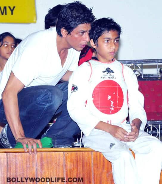 SRK offers Abhishek lessons on daddyhood