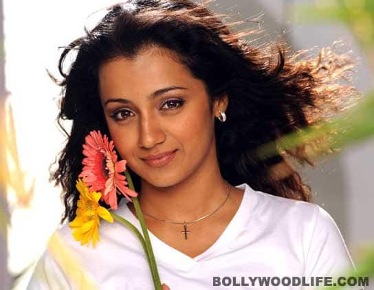 Homely Trisha bares her fangs!