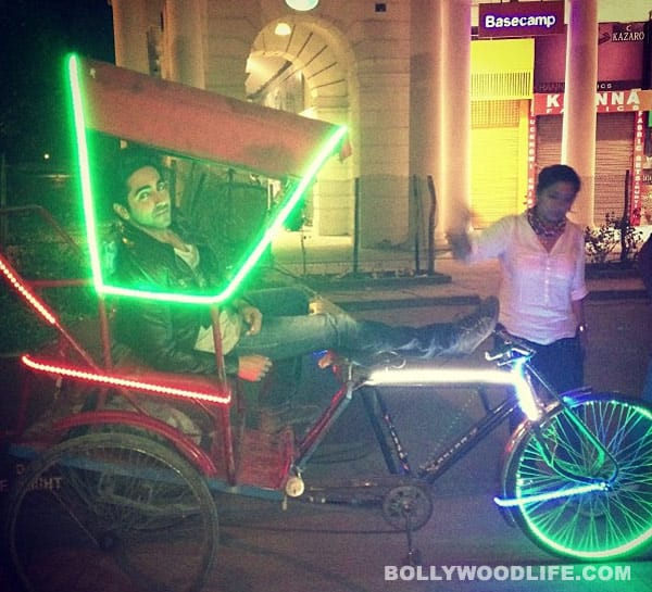 What is Ayushmann Khurrana doing in a cycle rickshaw?