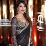 Priyanka Chopra lashes out at Mallika Sherawat for calling India regressive