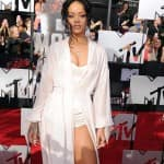 Rihanna flaunts her sexy figure in a lingerie-inspired costume at MTV Movie Awards 2014!