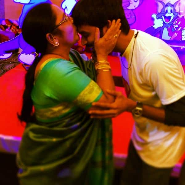 Mumma's boy: Dhanush receives a warm blessing from his mother-view pic!