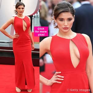 Nargis Fakhri attends the London premiere of her Hollywood film Spy dressed in a super hot cleavage-baring gown!