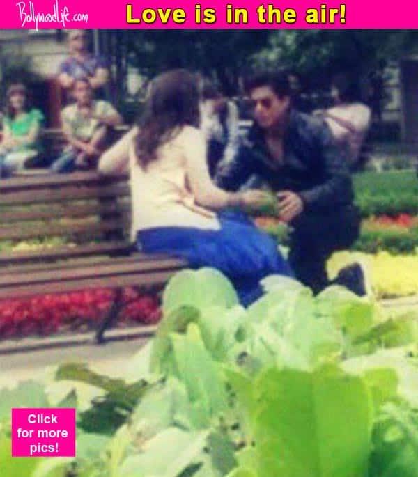 Aww! Shah Rukh Khan goes down on his knees for Kajol – view pics!