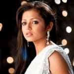Where does Drashti Dhami want to escape with Neeraj Khemka?