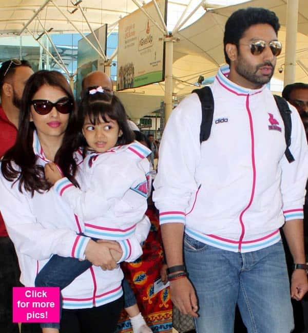 Abhishek Bachchan, Aishwarya Rai Bachchan and Aaradhya are totally colour co-ordinated at the airport – view pics!