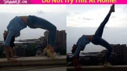 OH FREAK! Adah Sharma tries some daredevil yoga stunts on a terrace – watch video
