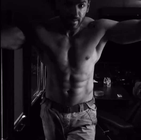 A shirtless John Abraham raves about Force 2 and we can't stop staring at his abs – watch video!