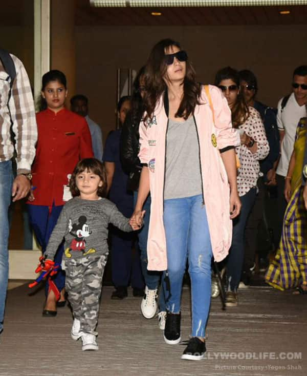 Not Shah Rukh Khan, Alia Bhatt walks hand in hand with AbRam at the airport – view HQ pics