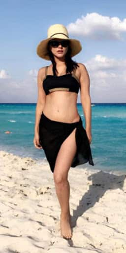 Sunny Leone looks blistering hot in her beach holiday pictures - check them out here