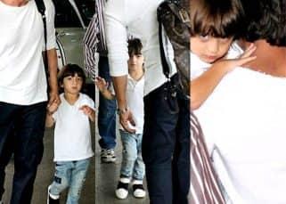 Dotting daddy Shah Rukh Khan comes to AbRam's rescue - view HQ pics