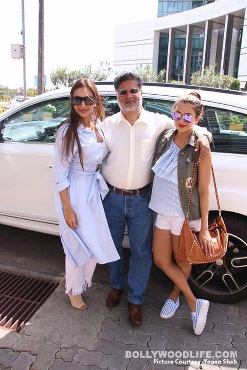 Malaika and Amrita with their father