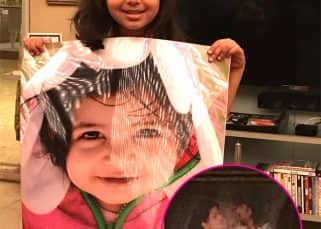 We love you Aaradhya but we couldn't help noticing this rare pic of Aishwarya and Abhishek Bachchan in the background!