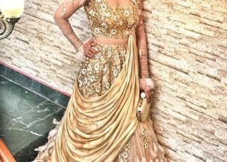 Divyanka Tripathi looks drop-dead gorgeous in her gold and feather gown - view pic