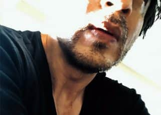 Shah Rukh Khan looks like THIS after cleaning up the gym and us mere mortals can only stare - view pic