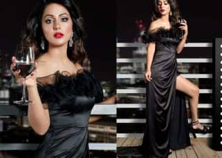 Hina Khan looks resplendent in a black slit gown and we can't help admiring her look - view pic