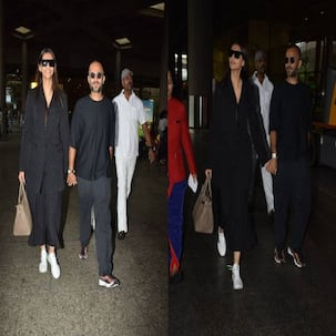 [HQ pics] Sonam and Anand are twinning in black as they return to the bay hand-in-hand