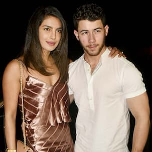 Nick Jonas didn't kiss Priyanka Chopra on their first night together at her apartment because Madhu Chopra was in the house - deets here