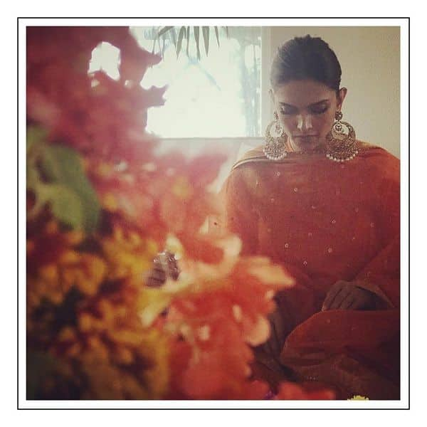 Ranveer Singh Deepika Padukone wedding Actress looks breathtaking in orange as she conducts a puja to begin the rituals