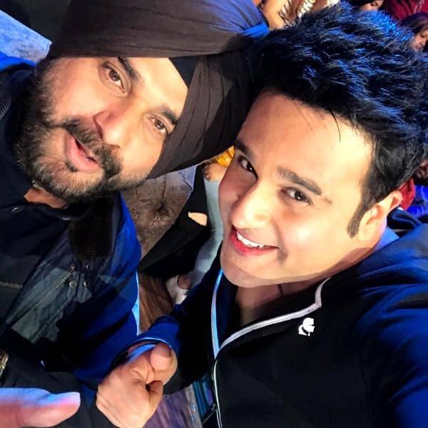 Krushna Abhishek poses with Navjot Singh Sidhu on the sets