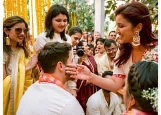 [UNSEEN PICS] Parineeti Chopra cannot stop smiling as she applies haldi on Nick Jonas' face during his wedding with Priyanka Chopra