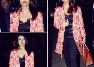 Spotted! Aishwarya Rai Bachchan makes a style statement as she capes her all-black ensemble with a pink jacket - view pics