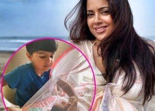 Sameera Reddy's son is fascinated by his newborn sister