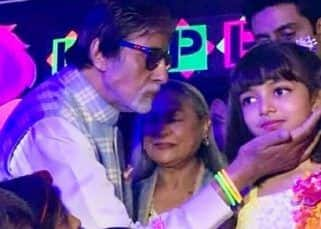 [Inside Pics] Amitabh Bachchan lovingly holds his granddaughter Aaradhya's face as she gets ready to cut her birthday cake