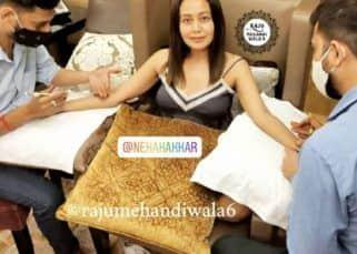 Neha Kakkar and Rohanpreet's mehndi pictures go viral as pre-wedding ceremonies begin