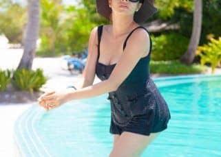 Tina Dutta looks classy yet sassy in the sexy black monokini - view pics