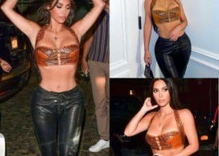 Kim Kardashian's latest look in a wide-legged faux leather trousers and a cropped corset top is all sexy, stylish and sultry – view pics