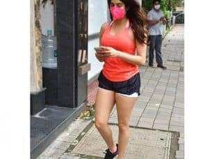 Janhvi Kapoor is looking at the phone but we are looking at her thanks to her stunning gym wear – see pics