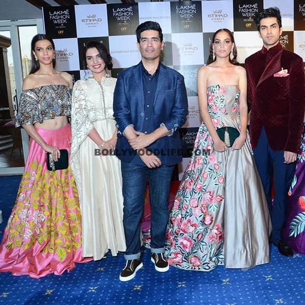 Models posing with designer Manish Malhotra during Lakme fashion Week 2016 preview