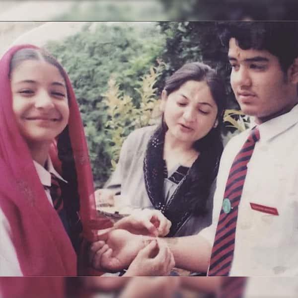 Little Anushka Sharma tying rakhi to brother Karnesh Sharma