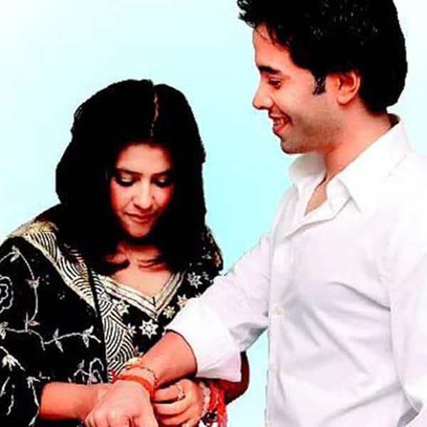 Ekta Kapoor tying rakhi to brother Tusshar Kapoor