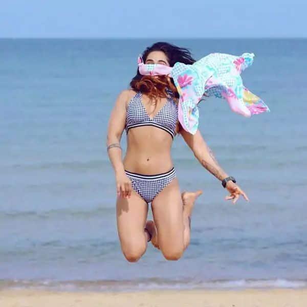 Flaunts her curves in bikini