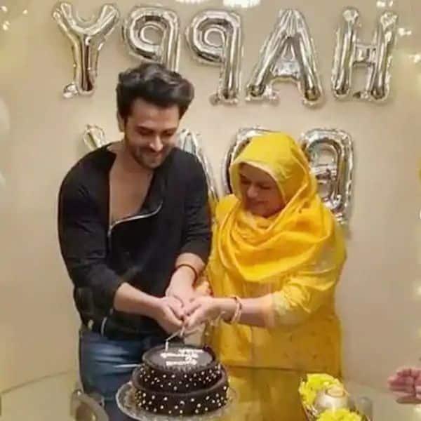 Shoaib Ibrahim cuts the cake with mom