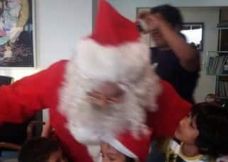 Aamir Khan as Santa with kids during Christmas party