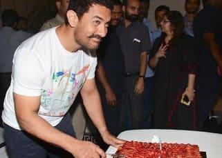 Aamir Khan cutting his birthday cake