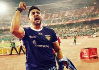 Abhishek Bachchan poses in a lungi at a football club