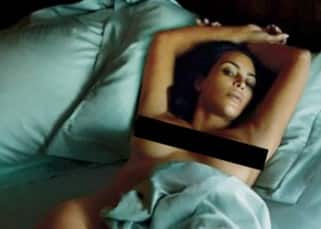 Kim Kardashian poses in bed nude for GQ magazine shoot