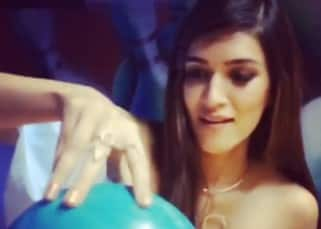 Kriti Sanon rolling the ball during Cosmopolitan magazine shoot