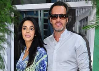 Mallika Sherawat and Cyrille Auxenfans wearing same shoes