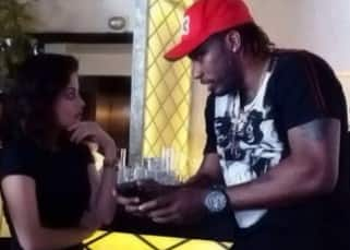 Sneha Ullal chatting with Chris Gayle during the party