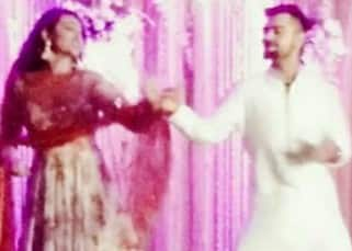 Sonakshi Sinha posing with Virat Kohli during sangeet ceremony