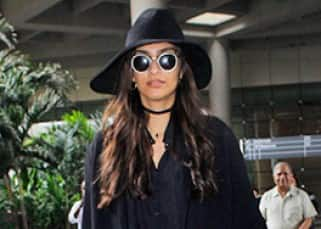 Sonam Kapoor turns a WOMAN IN BLACK as she returns from Paris Fashion Week!