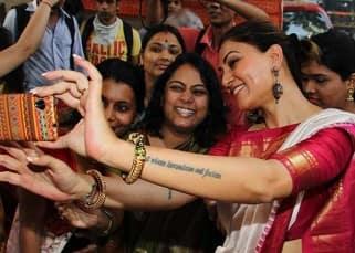 Sushmita Sen clicks selfie with fans on Durga Puja