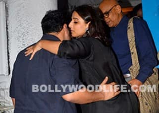 Vidya Balan snapped as she talks to her husband Siddharth at her nephew's birthday party