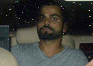 Virat Kohli snapped  in car prior to 'Sultan' screening