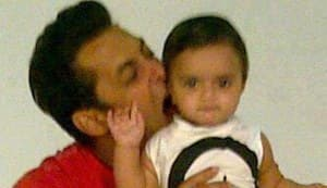 In Focus: Is Salman Khan biting into a kid's ear?